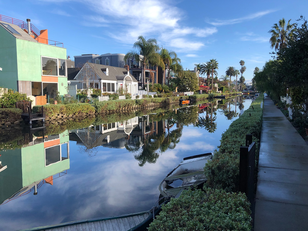 Wide angle view of sidewalk and Venice canal