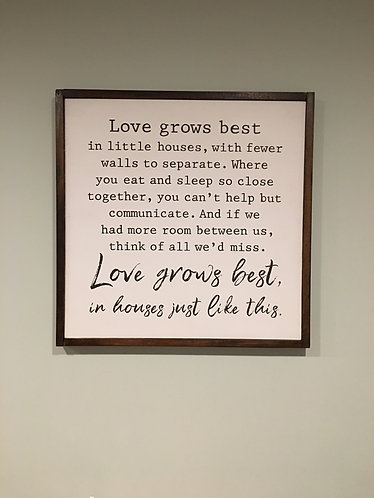 """Love grows best"" wooden sign"