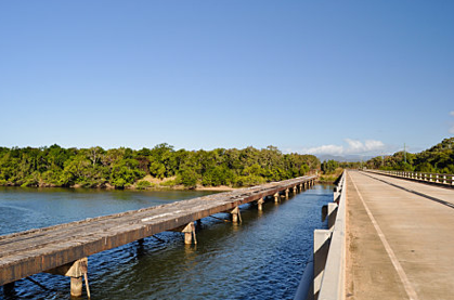 The original old wooden bridge [now heritage] crossing the Annan River alongside the new