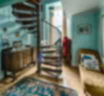 Spiral Staircase Leading to Family Room