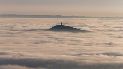 Glastonbury Tor surrounded by fog, Somerset, UK
