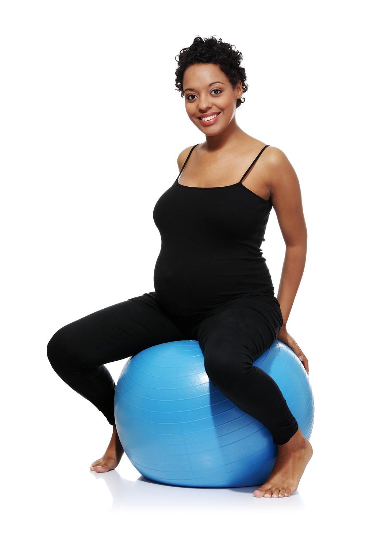 Pregnant woman using birth ball