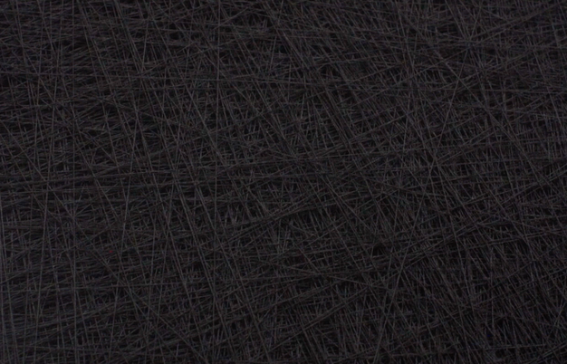 The work is heavy and thick with thread, the canvas frame is bowing and broken. The continuous thread is 13 miles long.
