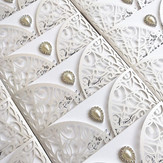 Classic laser cut wedding invitation with pearl & diamanté embellishment. Request a free and personalised sample by visiting www.jpg