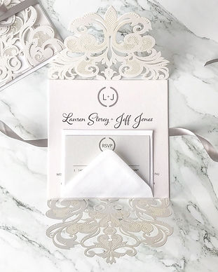 Laser Cut Invitation open with a lace pattern and ribbon