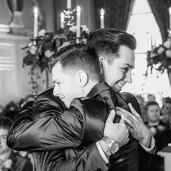 Phil & David Brookes-Lennon Hugging on their Wedding Day at Knowsley Hall