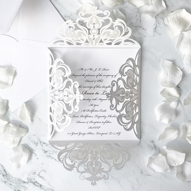 Understated Elegance. Classic white laser cut invitations with black calligraphy type.jpg