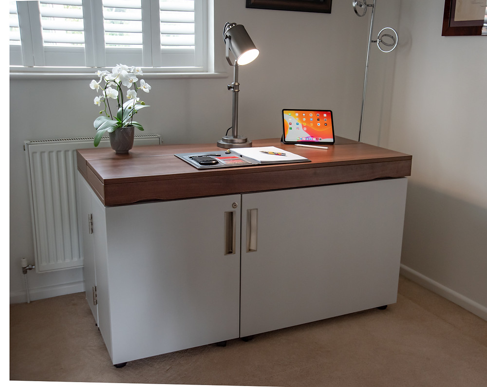 a stylish home office desk with the doors folded and closed to look like a sideboard