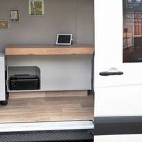 We bring our van to you so you can step inside and play with all Next Desk's features.  Feel how its compact design blends into any small space and gives you a powerful and organised space to transform your home working.