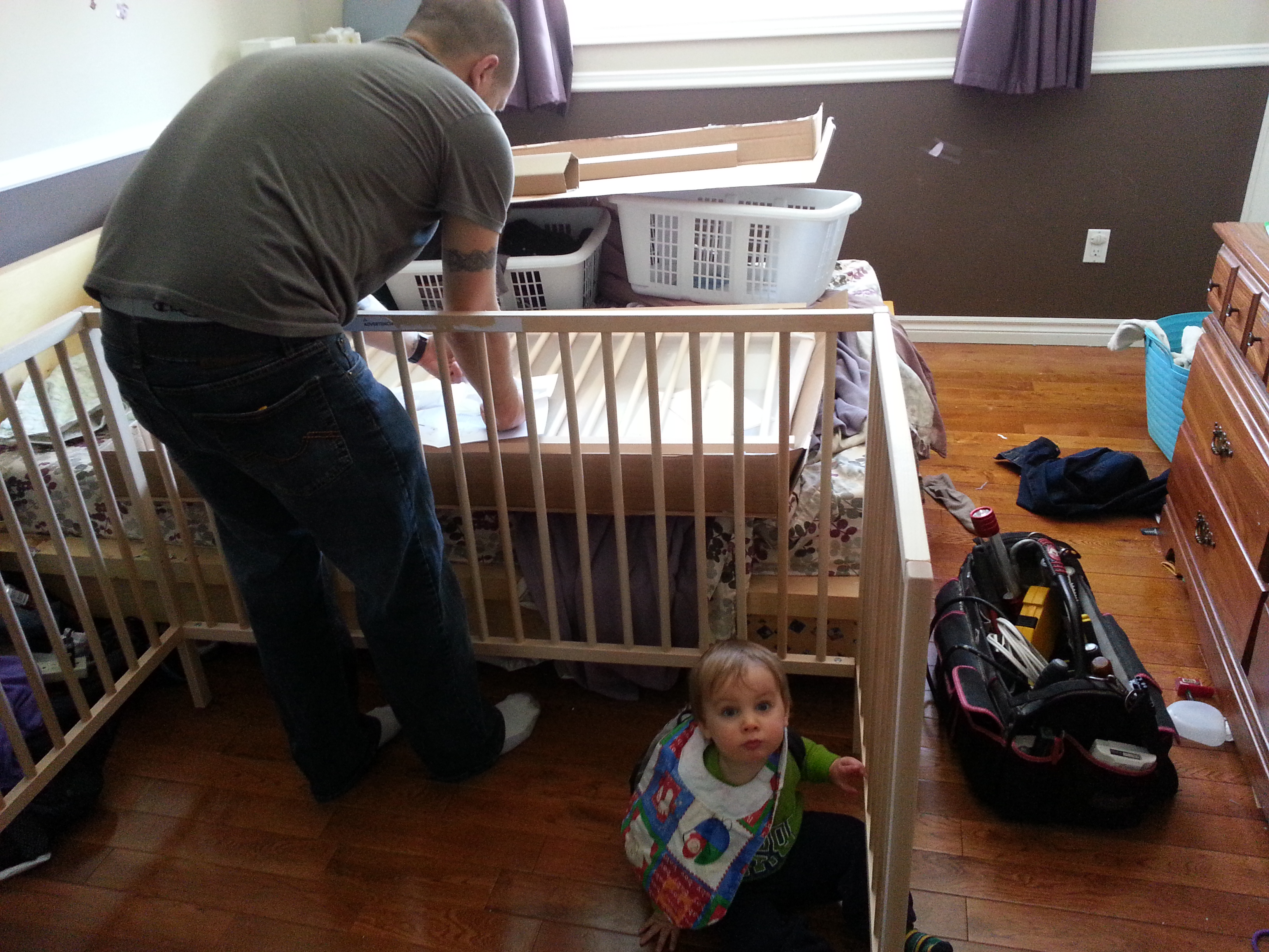 Feb 2015 Wyatt helping dad with new crib.jpg