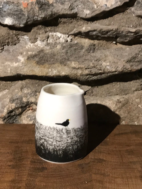 Blackbird on a stone wall creamer