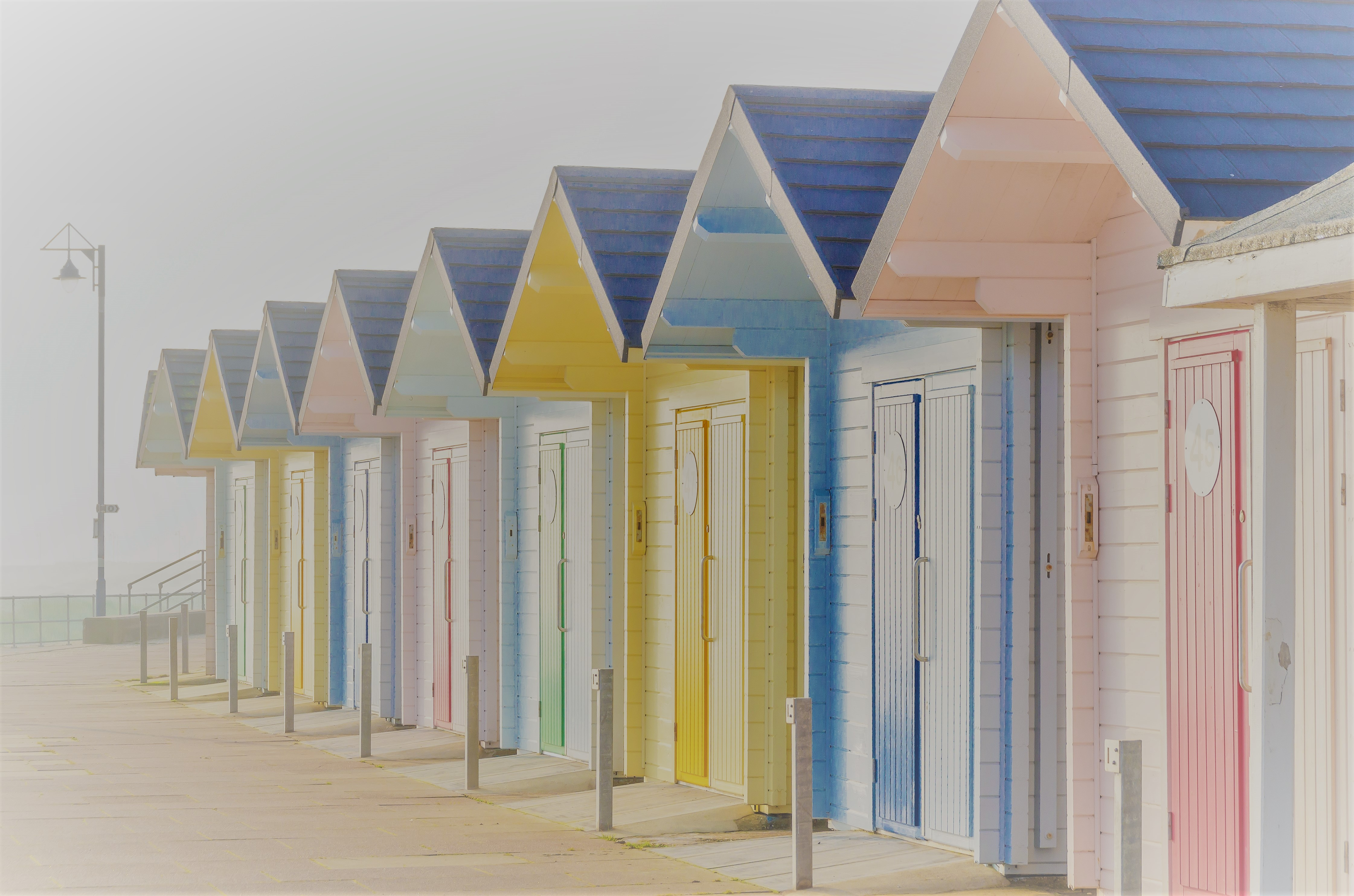 Beach huts in the mist
