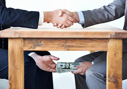 Bribe under table.jpg