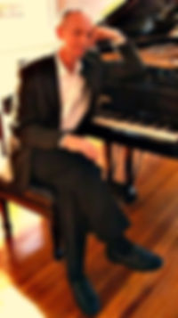 TW at piano smaller2.jpg