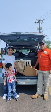 USMC family receiving a July 4th Meal Box.jpg