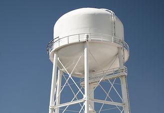 white 800 megahertz tower against clear, blue sky
