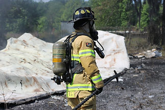 firefighter with oxygen tank