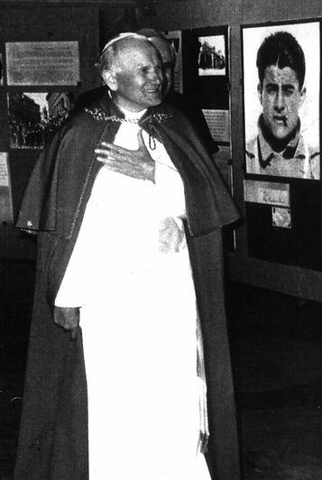 Photo of St. John Paul II viewing an exhibit of Bl. Pier Giorgio Frassati