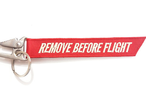 Chaveiro Remove Before Flight pequeno com mosquetão