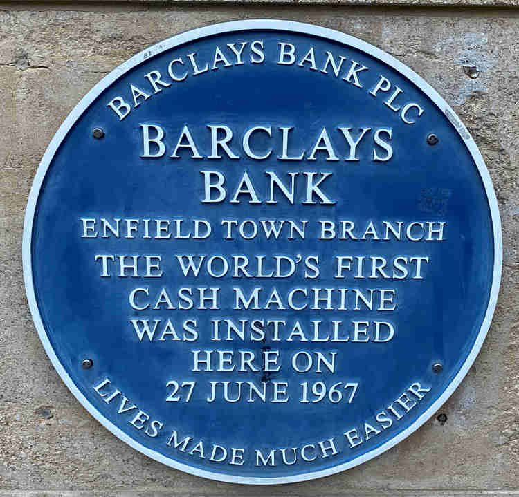 """A sign on the wall of Barclays Bank, Enfield Town which says: """"The world's first cash machine was installed here on 27 June 1967"""""""