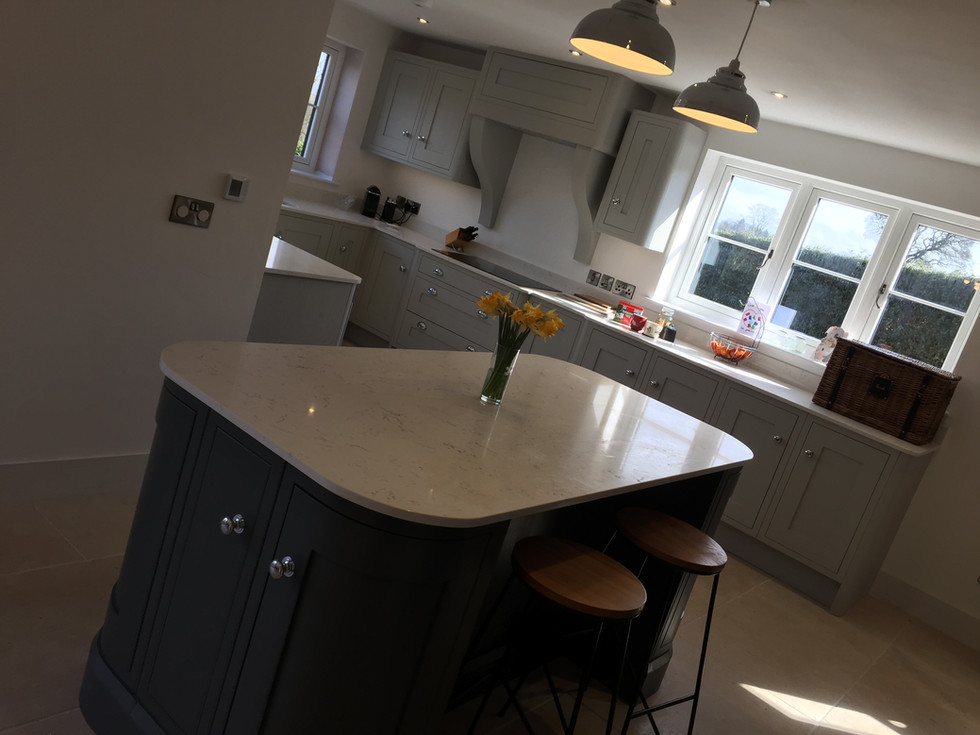 Bespoke inframe painted Oak fitted kitchen in Light Grey & Slate Grey. Quartz worktops and Neff applainces