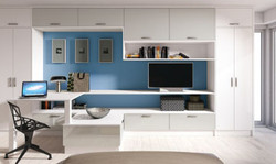 Blue bedroom with desk and cupboards
