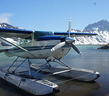 One of our cessna 206 aircraft sits on Surprise Lake, Aniakchak National Monument.