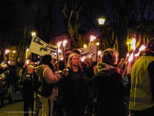 Carbonne: une marche des flambeaux en chants.