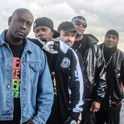 Publicity shot for music video 'This is the time' with (left to right) Mr.Zip, Donald-D, Director Lee Bolton, Lenell Brown and Dynamax.