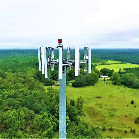 Communications tower using zoom lens cap