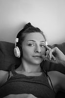 Female model listening to music and relaxing _edited.jpg