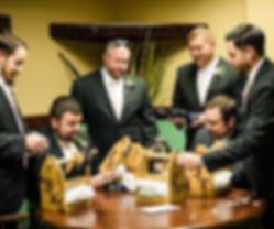 Just a bunch of dapper groomsmen checkin