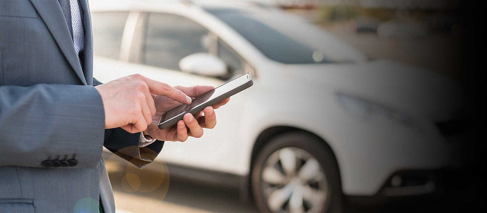 businessman-with-smartphone-in-front-of-car.jpg