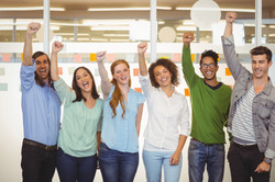 photodune-13077322-portrait-of-excited-business-people-with-arm-raised-in-office-l