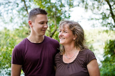 cheerful-mother-with-adult-son-outdoors-