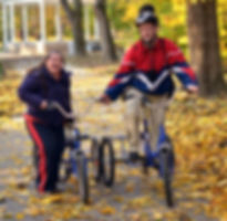 _ down syndrome couple on bicycles in th