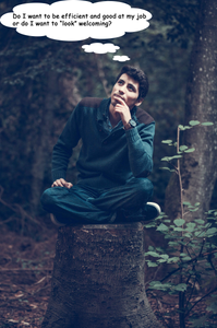 man sitting on tree stump in forest
