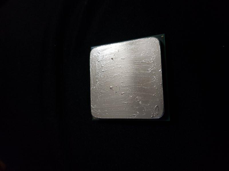 Coollaboratories Liquid Pro Thermal Compound spread across CPU