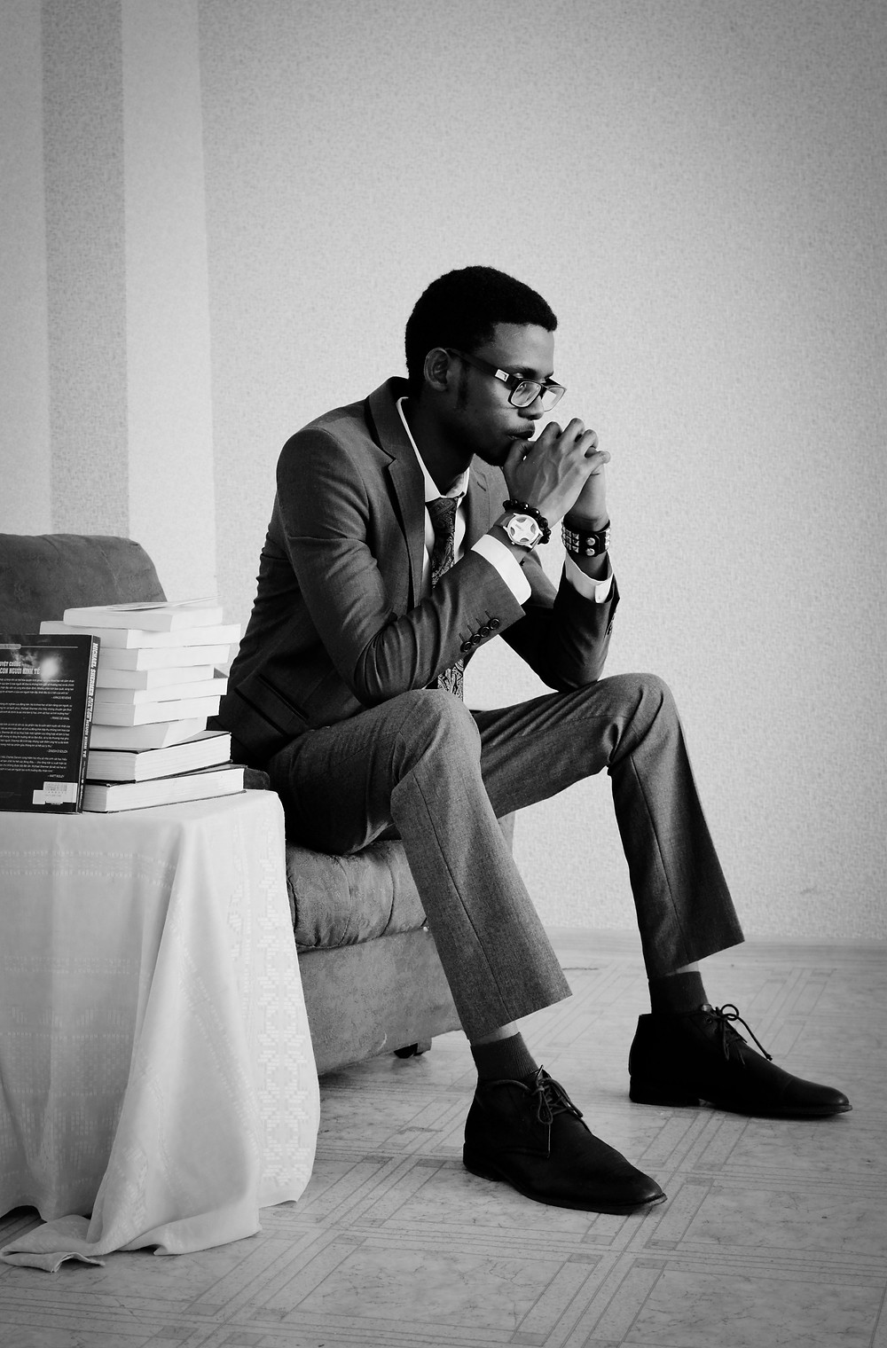 Black Man thinking on chair