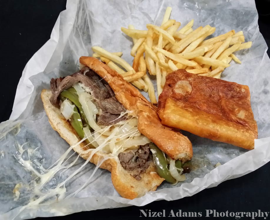Little Mel's philly cheese steak, pizza puff & fries combo