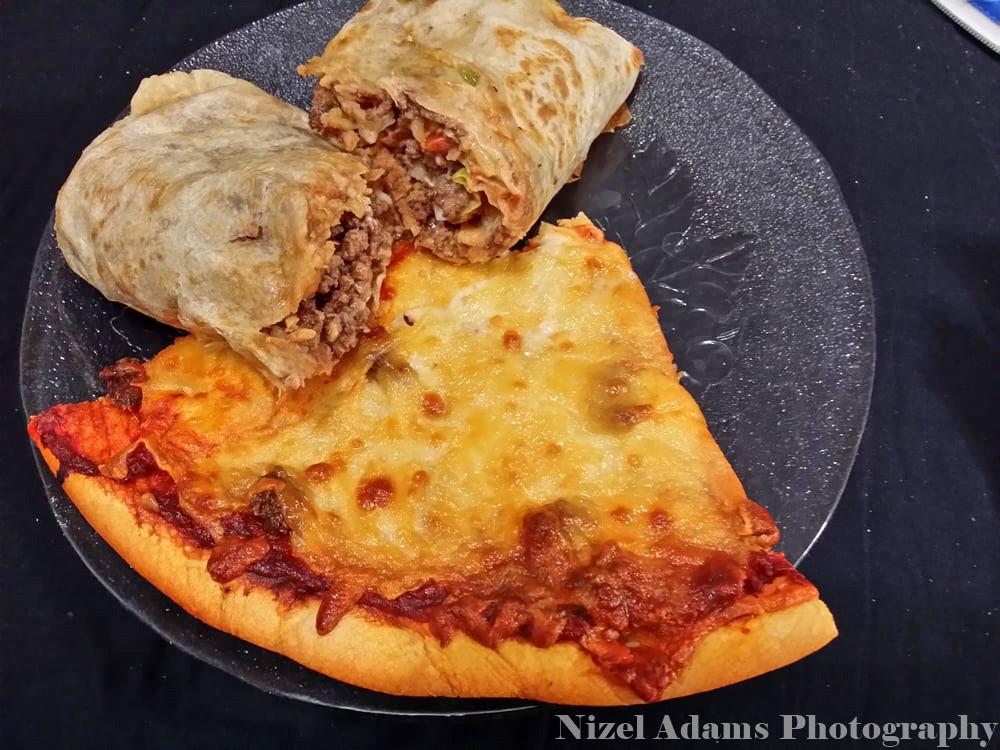 little mel's sausage pizza slice