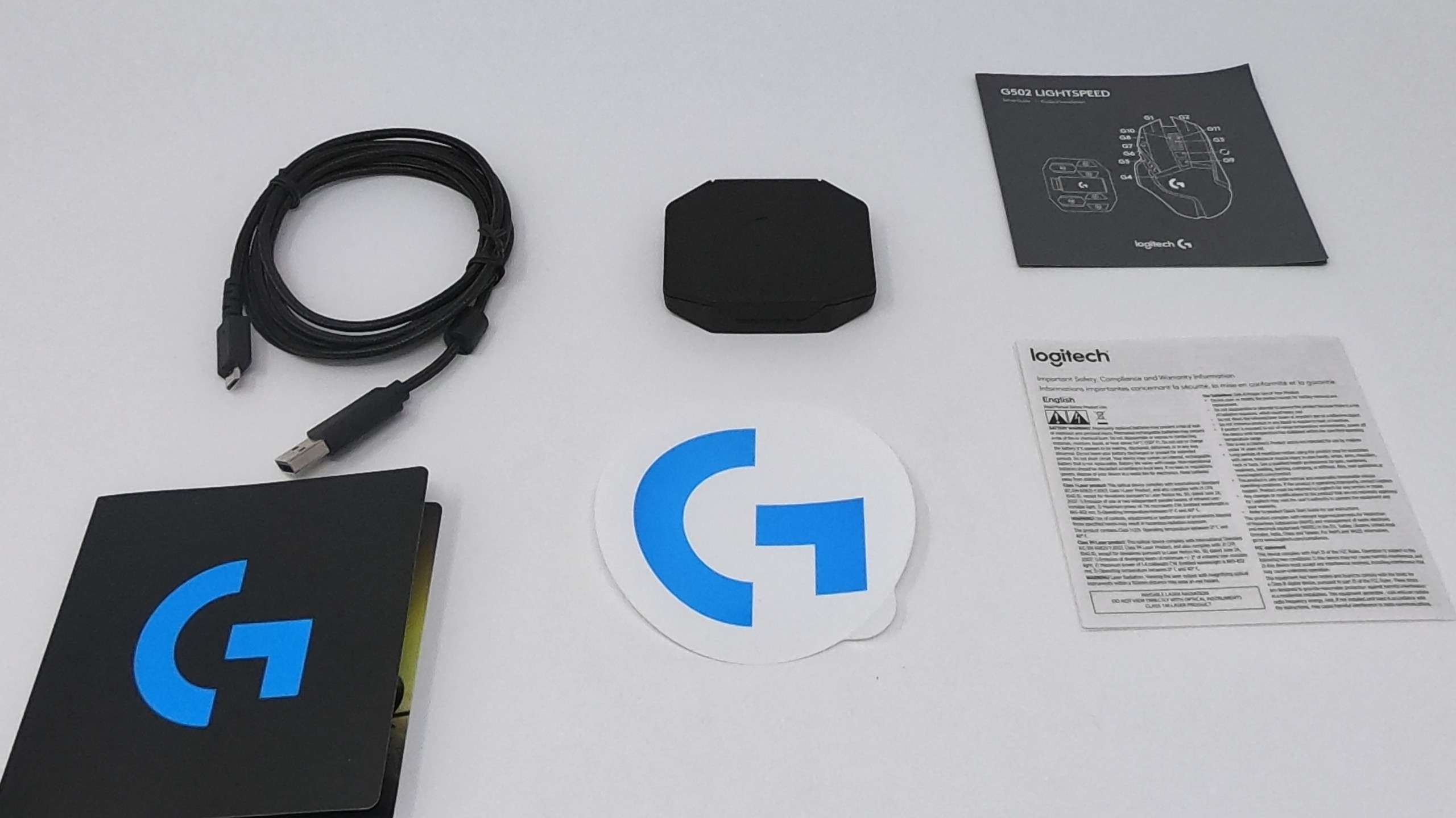 Logitech G502 Wireless, USB Cable, Weights, G Sticker, Manual