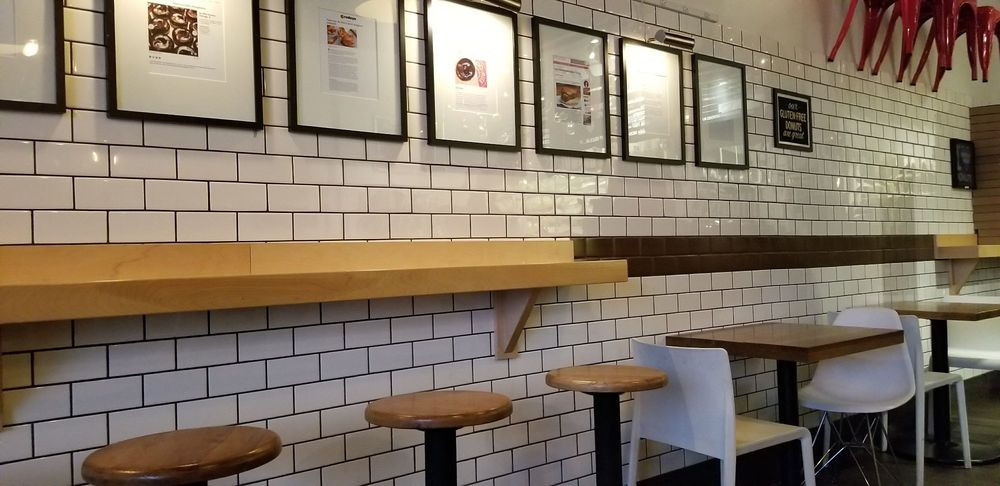 Do-Rite's Interior Wooden Seating with brick textured wall