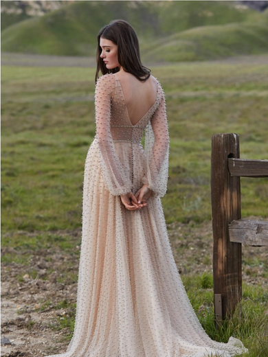 Style: Pisces  Studded with a seaside's worth of faux pearls and finished with a sweeping train, our plunge-necked (and fully lined) gown was made for the bride who possesses hidden depths.  SIZES: 00–24W