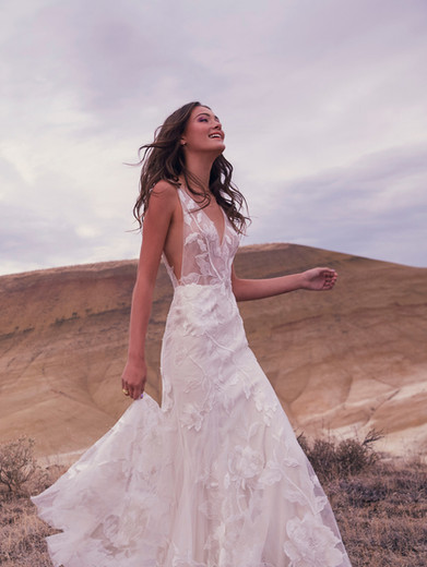 Style: Honor  When you want an incredible gown you can wear (without it wearing you), there's our fit-and-flare Honor. Crafted of unlined airy tulle with overlaid ivory floral lace, it's just that easy to fall for.  SIZES: 00–24W