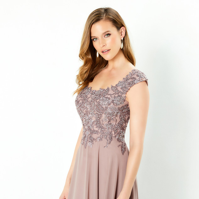 Style: 220940  COLOR: Charcoal, Mink   SIZES: 4 - 20, 16W - 26W  DESCRIPTION DETAILS Sleeveless chiffon a-line gown with a scoop neckline lace appliques on the bodice, natural waist, crystal accents and a sweep train. Shawl Included