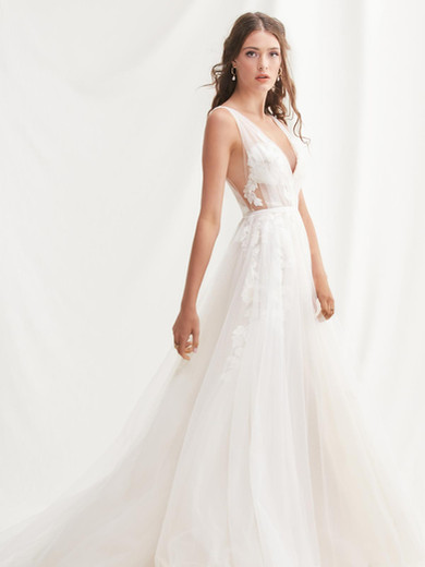 Style: Lainie  If you want to reveal a little skin—but not too much—a lush gown of illusion tulle laid over with Wildfell Lace is just the thing for the slightly bolder bride.  SIZES: 00–24W