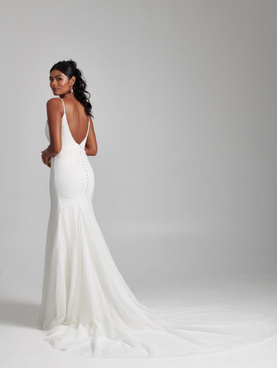 Style: Skylar  Ethereal Point D'esprit Tulle creates a chic and romantic silhouette in our Skylar gown. Featuring a plunging V-neckline and boned bodice, and a fit-to-flare skirt with double layer stretch lining, the look finishes with a dramatic Tulle train.  Available sizes: 00-30