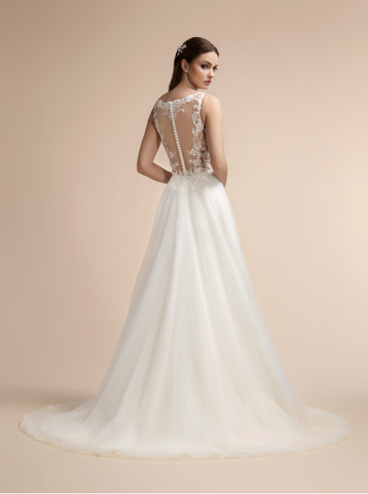 Style T911  SIZES 2-28  FABRIC Embroidered lace appliques with sequin  SHOWN IN Ivory  AVAILABLE COLORS Ivory, White