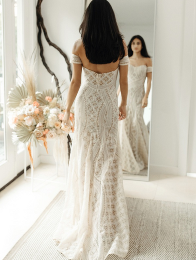 Style: Sierra  Strapless fit and flare gown paired with detachable armbands. This gown is made from custom perfectly hand-placed embroidery to flatter the body.  Sizes: 00-24W